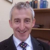Mr. Tom McGuinness